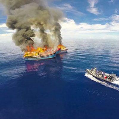 media production palau boat burn stock footage
